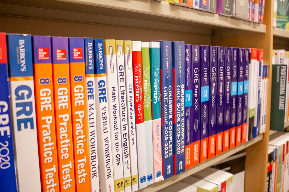 several GRE study guides on a shelf